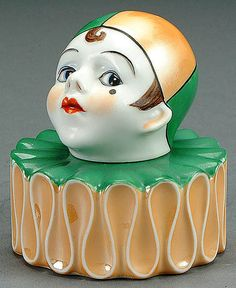 A NORITAKE FIGURAL HARLEQUIN PORCELAIN INKWELL CIRCA 1925 TWO PART FORM OF A HARLEQUINS BUST OF RUFFLED BASE WITH PAINTED FEATURES