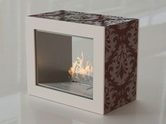 This bio-ethanol fireplace is simple and elegant. The rectangular shaped fireplace is designed with colored patterns to add a touch of beauty and style to your place. Rectangular, New Homes, Decor, Interior Design, Furniture, Home, Interior, Fireplace, Home Decor