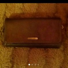 Nine West Wallet!!! Firm unless bundled Has incredibly large amount of room for credit cards, holders & compartment for check book & ledger, spacious zipper compartment for change, has 2 different snapping levels (just in case it gets too fat with all of that $ - you make more room with 1 snap! In excellent condition!! Nine West Bags Wallets