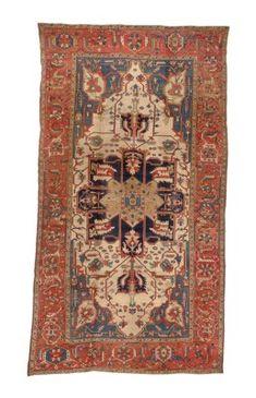 HERIZ CARPET  NORTHWEST PERSIA, LATE 19TH CENTURY  Approximately 15 ft. 6 in. x 8 ft. 10 in. (472 cm. x 269 cm.)