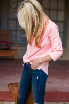 Button down tucked into the front of dark jeans! I love the loose look hanging out in the back.