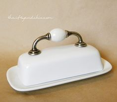 Thrifty and Chic -  door handle glued to a butter dish.