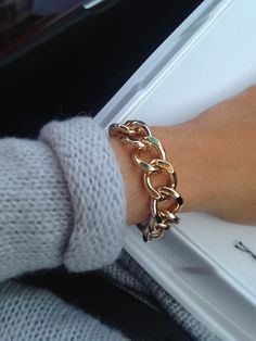 j'adore . I have been wanting a chain bracelet and they all seem too chunky and obnoxious . This one i could handle .
