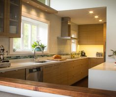 Example of Snow White Quartz countertops with light wood cabinet stain