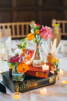 Each table has different theme -- books as flower vase stand, or the sheet music, and occasional lanterns, silver animal figurines, etc