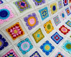 """Ravelry: Maryfairy's """"Karisma"""" for Natasha..This blanket is a combination of different colored basic granny squares and different colored flower squares..free pattern for both squares and border!"""