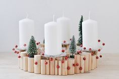 Adventskranz aus Holz mit kleinen Tannenbäumen / advent wreath with little christmas trees by Sinnenrausch via DaWanda.com