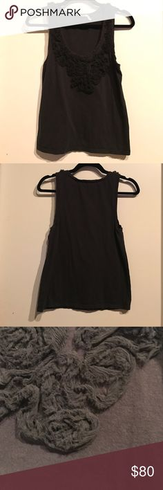 """Black tank with ruffle flower detail Never worn. Cute casual or dressed up! Open to reasonable offers. 30"""" chest. 21"""" length. 100% cotton. Juicy Couture Tops Tank Tops"""