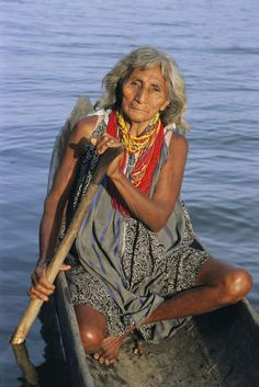 A Warao Indian in a canoe.' by National Geographic
