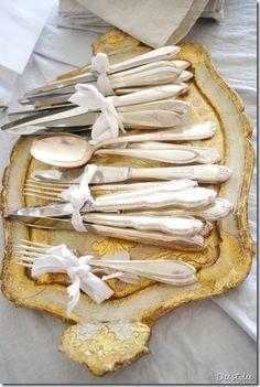 Silver bundled on a vintage tray makes a lovely display.