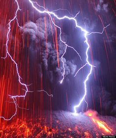 volcanic lightning --- Martin Rietze, the photographer behind the website Alien Landscapes on Planet Earth, is willing to do whatever it takes to get a great photo -- even if that means inching towards a volcanic explosion while scalding lava spews into the air and lightning strikes from dark clouds above.
