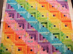 "Rainbow straight furrows  Rainbow log cabin quilt in straight furrow setting. It's made with using Fat Quarters, not strip sets. These strips are 1-1/4"" wide, finished ~ so cut size is 1-1/2"", as you would do 1/4"" seams.  NICE!"