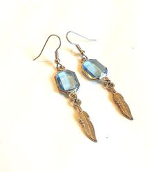 SIlver and Blue Feather Earrings  Light by DCArtandPhotography