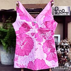 LILLY PINK and White V-Neck Hibiscus Floral Top Adorable empire waist v-neck sleeveless top. No flaws.. Side zip, fully lined. Tagged size 0, This would fit a 32a/b best.  Measurements to follow. Lilly Pulitzer Tops