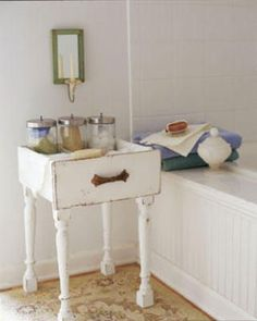 Combine legs from an old chair or table with your dresser drawer to create a useful storage table.  Set it next to the bath  to keep your bath salts and towels handy!  (If you don't have any old legs for this you can buy new ones at the home improvement store.) could also make nightstands for our bedroom.... Hmmmm.