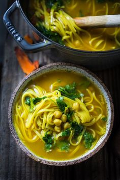 A healing detoxing pot of soup-Turmeric Broth with chickpeas, rice noodles, greens, or make it your own. Nutritious and cleansing. Vegan, Gluten Free.