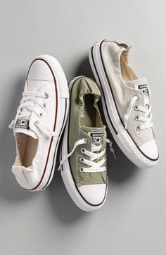- Crisp white canvas is complemented with red and blue stripes on a classic sneaker fitted with hidden elastic at the tongue for easy slip-on wear. The first basketball-specific shoe was the Converse