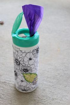 Dog-lovers, here's another craft for your finished canisters of disinfectant wipes: Use them to store your rolls of poo bags in between walks. Nàe Chic made the container a little more glam using spray adhesive and fabric.