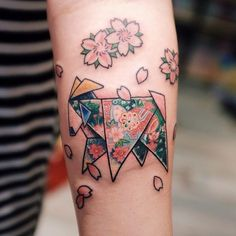 Origami goat tattoo to represent her daughter