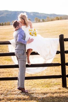 This wedding was at Spruce Mountain Ranch and has great back grounds including the pond, forestry areas, paddocks, open prairie, mountain scenery and ancient oak trees. A very romantic western setting for this country themed bride and groom.