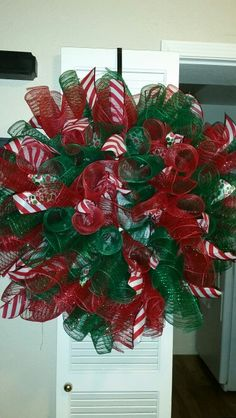 Curly Christmas deco mesh wreath by MrsPaula Spring Door Wreaths, Christmas Mesh Wreaths, Christmas Crafts, Christmas Decorations, Winter Wreaths, Prim Christmas, Summer Wreath, Christmas Ribbon, Wreath Crafts
