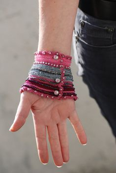 Crochet cuff bracelets are perfect for winter styling. Vibrant color handmade crochet cuffs are grea Cute Crochet, Crochet Yarn, Crochet Flowers, Crochet Stitches, Crochet Patterns, Crochet Beaded Bracelets, Crochet Bracelet, Wrist Warmers, Freeform Crochet