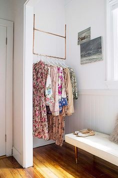 You may not have a walk-in closet, but even an unused nook or corner can serve as an impromptu closet if you hang a DIY copper-pipe rack.