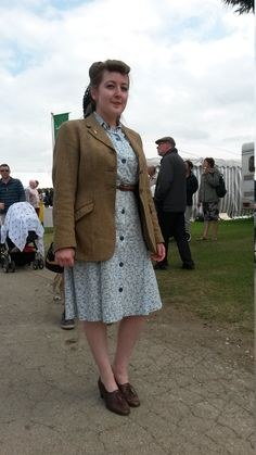 Lydia from the Lincolnshire Aviation Heritage Team at RAF Scampton, showing great dress-sense - 1940s style. This tweed jacket looks brilliant teamed with a feminine summer dress and simple, lace-up shoes. It's a classic style we'd love to see back on our high street! Come on girls, take your inspiration from 1944... it looks great! (and well done on achieving perfect Victory rolls - we adore the hairstyle!) Aviation Wedding, Victory Rolls, 1940s Style, 1940s Fashion, Tweed Jacket, Lace Up Shoes, Well Dressed, Dapper, Classic Style