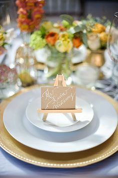 calligraphy escort card displayed on an easel