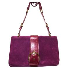 Stunning Plum Suede Coach Purse Gorgeous deep plum/raspberry suede bag with lavender interior. Brass finishes (has a little tarnish) with leather strap. Suede does show some wear from gentle use. I need to make room in my closet so I must part with a few of the bags in my collection. My shopping addiction is your gain. Cloth dust bag included. Smoke free home. Coach Bags Shoulder Bags