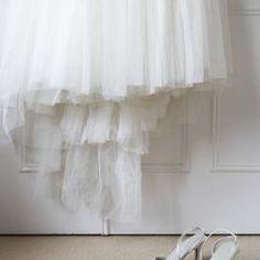 A detachable wedding skirt adds drama to a short wedding dress.