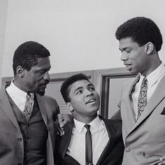 Bill Russell & Lew Alcindor (Kareem Abdul-Jabbar) With Muhammad Ali at the Sports Summit of the Top Black Athletes that Assembled in Cleveland Ohio for a Press Conference to Support Muhammad Ali's Refusal to enter the Army Draft (1967)