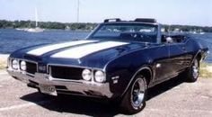 A buddy in high school had one exactly like this. Beautiful 1969 Oldsmobile 442.