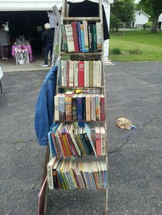 we displayed books at our garage sale using an old ladder Garage Sale Organization, Organizing, Garage Sale Signs, Yard Sale Signs, Old Ladder, Rummage Sale, Vide Dressing, For Sale Sign, Fleas