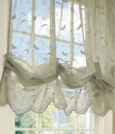 This sheer balloon curtain addslittle privacy and protection from the sun. I like the pattern on this shade however I don't like the color at all. Although, I think this shade would look lgood in a kitchen.