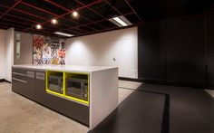 Maxus | The Bold Collective | Office kitchen breakout area polished concrete and marmoleum floors pop yellow and red with pop art