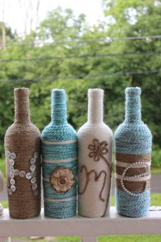 These re-purposed Home bottle decorations are the by TheWineWrap. Centerpiece ideas. I drink enough wine I could make a million of these...