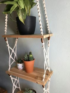 Three tier macrame and cedar shelf, With fun wooden beads and colorful earthy hanging strings. Hang plants, trinkets, picture frames and other light weight and fun items from this vintage, nature, and bohemian inspired macrame shelf.  The shelves are each about 15 x 7. Made from unfinished real Cedar wood (smells fantastic as well!) There is about one foot of space between each shelf for your plants and other nifty items. The total height of the shelf from ceiling to floor is about 90 (7…