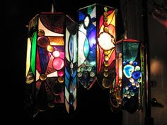 838 euros .... Oh to win the lottery ... I adore this work !!!  Agate Pendant Lamp by Woodlandstainedglass on Etsy