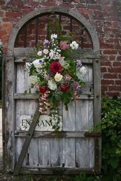 weathered gate with fresh flowers