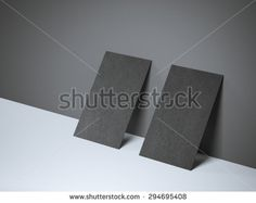 Two black blank business cards