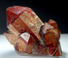 Red Phantom Quartz - Orange River, Karas Region, Namibia This terrific red phantom cluster comes from Heini Soltau, the man that popularized the Namibian orange river quartzes during the early 2000's. A unique phased mineralization is seen.