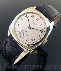 A 9ct gold cushion vintage Longines watch, 1946