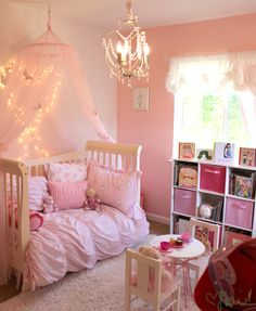A Chic Toddler Room Fit For a Sweet Little Princess I really like the idea of lights over the bed. They look like stars.