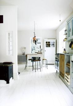 I love white kitchens, but I'm also very aware that they would not stay white very long in my house