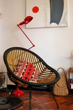 Like the retro red and black theme, with lovely parquet floors in Heather Moore's home courtesy of apartmentherapy.com
