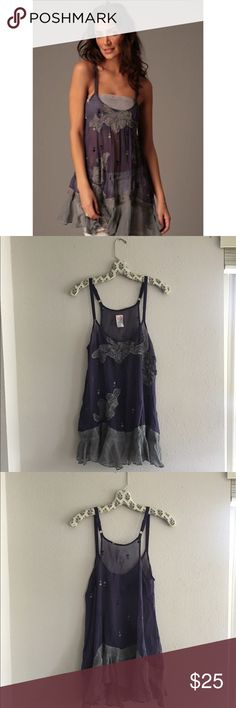 RARE Free People Embroidered Embellished Tank Sheer tank from FP with floral embroidery / embellishment. Super cute ruffle hem. Adjustable straps! Size 6 which is about a Medium or Small. Could look cute if worn oversized on someone who is an XS Free People Tops Tank Tops