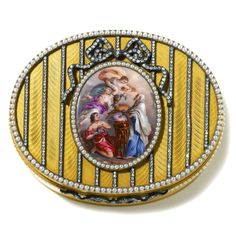A Fabergé gold, diamond, enamel and seed pearl snuff-box, workmaster Henrik Wigström, St. Petersburg, 1899-1908, the hinged lid centred with a Swiss enamel plaque depicting the Sacrifice of Iphigenia, tied at the top with a diamond-set bow and mounted with similar diamond bands, the plaque, and edges of the lid set with seed pearls, diamond-set bow thumbpiece, the whole enamelled in golden yellow translucent enamel over a wavy engine turned ground.