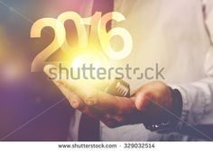 Happy new 2016 business year, businessman with light bulb and number 2016, retro toned image, selective focus. - stock photo