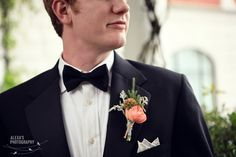 Groom with boutonniere and bow tie.